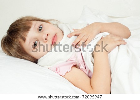 The girl lies in bed, measures temperature - stock photo