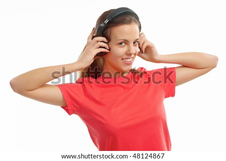 The girl listens to music in ear-phones