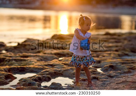 the girl of the sea, playing in the sand in Cyprus - stock photo