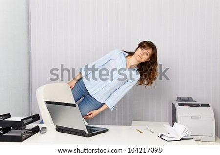 The girl - office worker goes crazy with work - stock photo