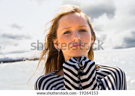 The girl on a beach in bad mood - stock photo