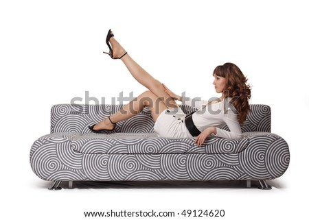 The girl on a sofa - stock photo