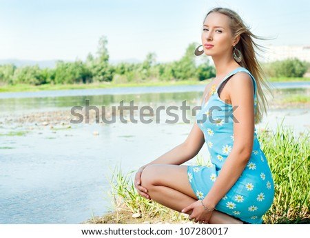 The girl on the bank of the river, the summer