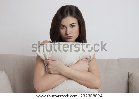 The girl on the couch. emotion. Interior light room