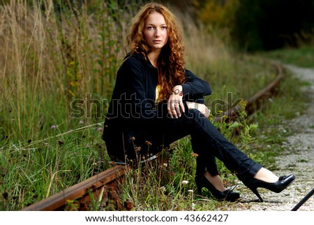 The girl on the railroad. - stock photo
