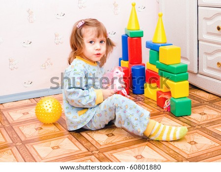 The girl plays with toys - stock photo