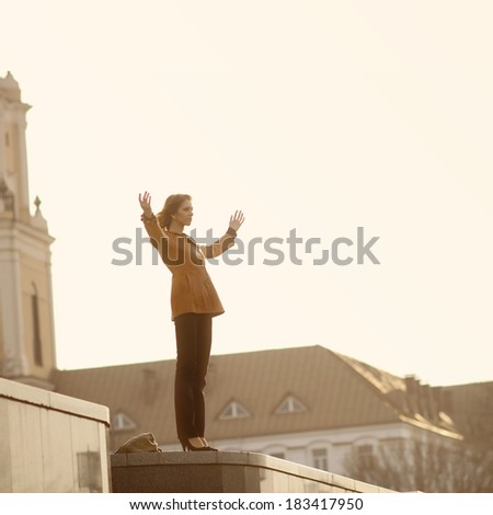 The girl raised her hands to the sky - stock photo