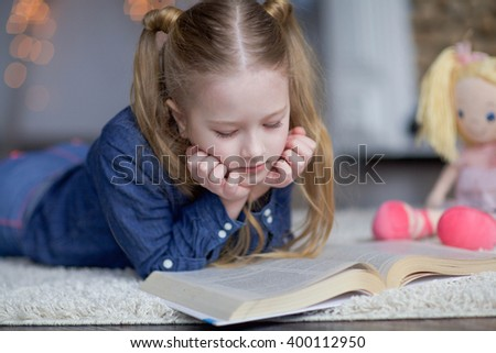 the girl reads  - stock photo