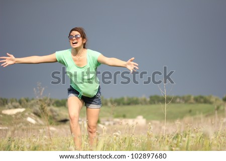 The girl runs on a grass