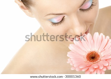 The girl sensually inhales aroma of the pink flower, isolated - stock photo