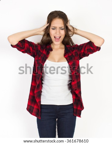 the girl shouts expressing negative emotion. it is photographed in studio on a white background - stock photo
