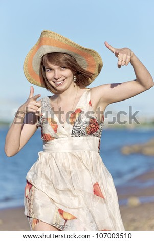 The girl shows fingers - stock photo