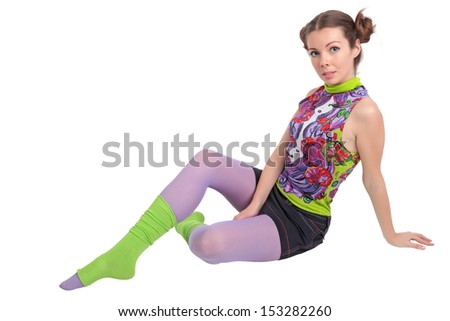 The girl sits on a floor, is isolated on a white background