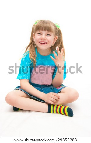 the girl sitting on a white background