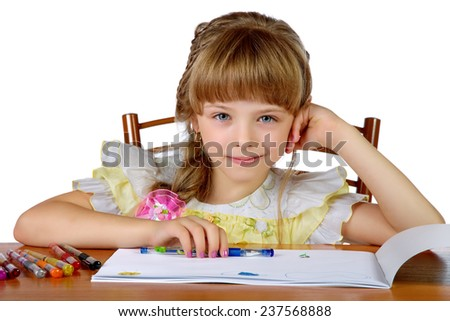 The girl smiling draws in an album - stock photo