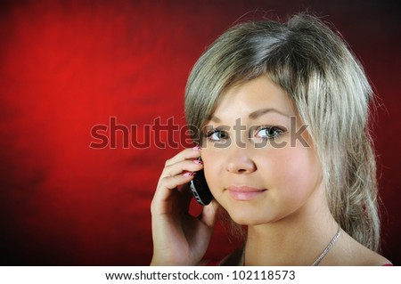 The girl, speaking on phone.
