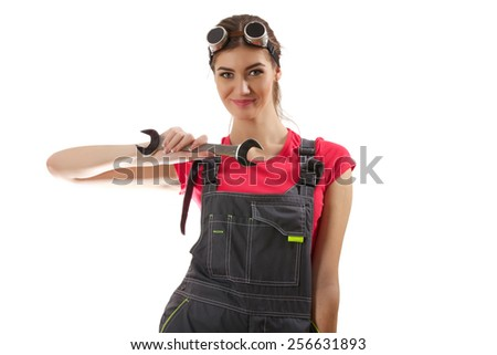 The girl stands with a wrench in her pocket