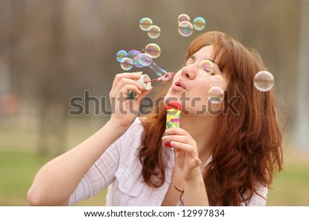 The girl starts up soap bubbles