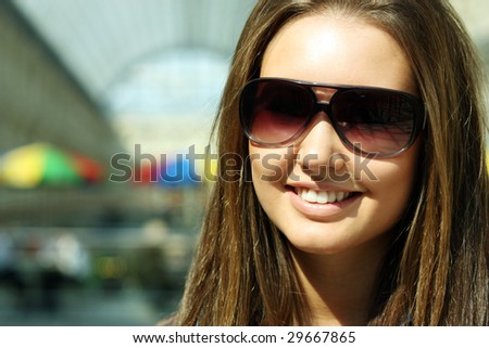 The girl the brunette with solar glasses
