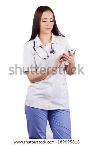 The girl the doctor dials number on the mobile phone. It is isolated. White background.