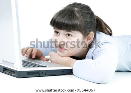 The girl the teenager sits with the computer on the isolated white background