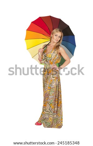 The girl under an umbrella in full growth - stock photo