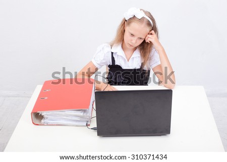The girl using his laptop computer on white background.