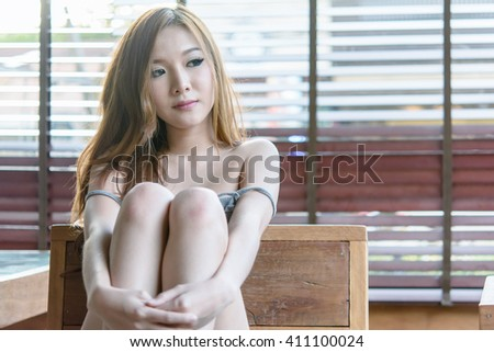 The girl was stripped Showing shoulders and chest ,Asian girl with big breast with soft focus , Selective focus ,sexy girl portrait - stock photo