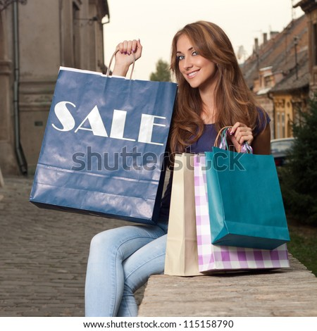 The girl who returns from sell-off - stock photo