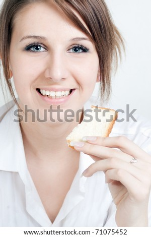 The girl with a bread slice in a hand