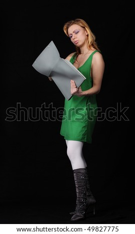 The girl with a folder on a black background