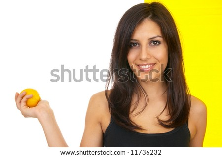 The girl with a lemon in a hand - stock photo