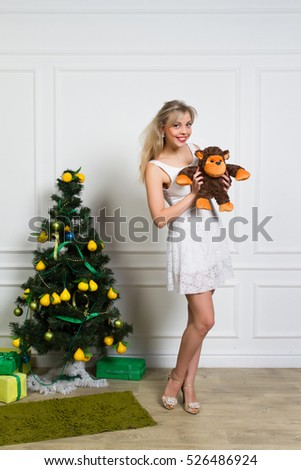 The girl with a soft toy for Christmas