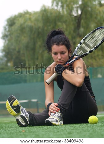 The girl with a tennis racket - stock photo