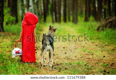 "the girl with a wolf go on the wood.  the fairy tale "" Red Riding Hood"" - stock photo"