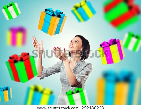 The girl with gifts flying from above - stock photo
