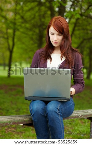 The girl with laptop on outdoor
