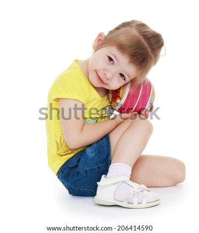 The girl with the ball.happy childhood, carefree childhood concept. - stock photo