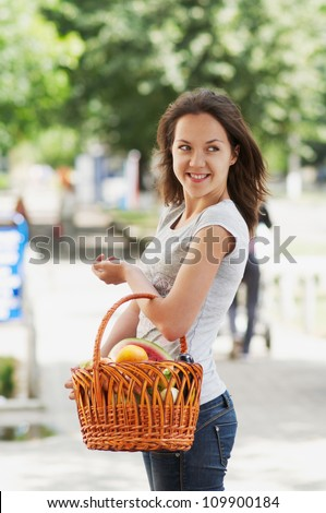 The girl with the basket in the street
