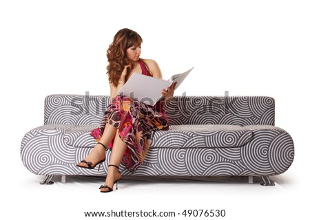 The girl with the book on a sofa