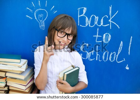 The girl with the books preparing to the new school year