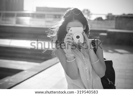 The girl with the camera in the city. Black and White