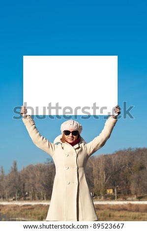 The girl with the poster - stock photo