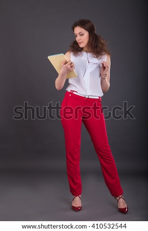The girl with the tablet on a dark background - stock photo