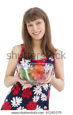 The girl with vegetables in hands, White background - stock photo