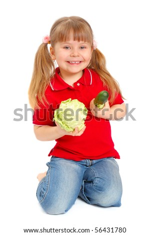 The girl with vegetables on the white - stock photo