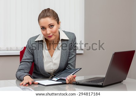 the girl working at the computer