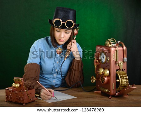 The girl writes down the text heard by phone. - stock photo