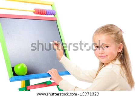The girl writes on blackboard - stock photo