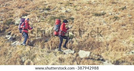 The girls go on a Hiking trail with backpacks.